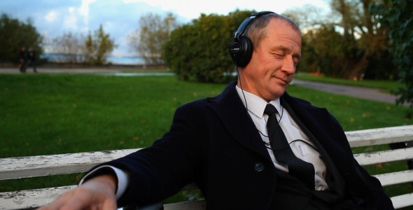 Senior_Businessman_Enjoying_Music_Outside__2